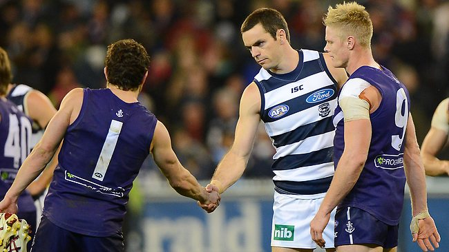 Geelong veteran Matthew Scarlett shakes Hayden Ballantyne's hand after what could be his last AFL match. Picture: George Salpigtidis