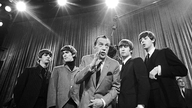Pop culture moment...In this Feb. 9, 1964 file photo, Ed Sullivan, center, stands with The Beatles during a rehearsal for the...