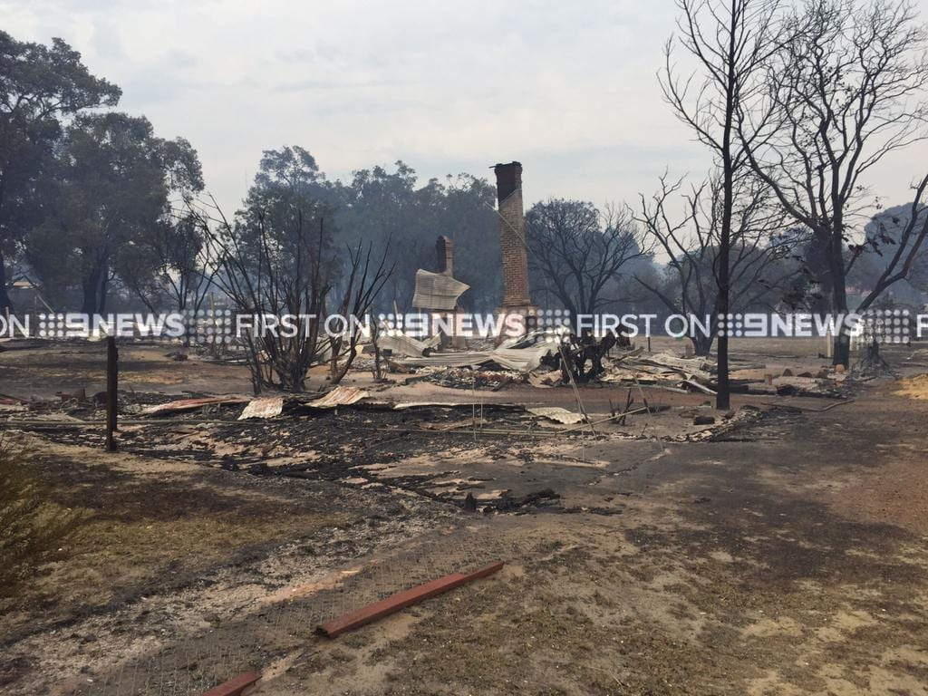 Destroyed buildings at the bushfire zone in Yarloop on Friday morning. Supplied by Nine News Perth.