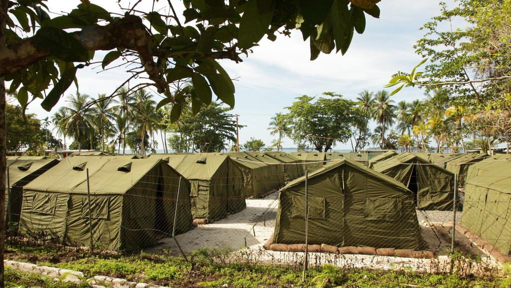 A violent incident at Manus Island detention centre last week was sparked by asylum seekers allegedly leading a five-year-old local boy into the centre.