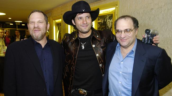 <i>Sin City</i> co-director Robert Rodriguez (centre) with Harvey and his brother Bob Weinstein. Picture: AP / Chris Pizzello.