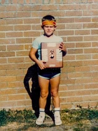 A young Cameron with a sporting award.