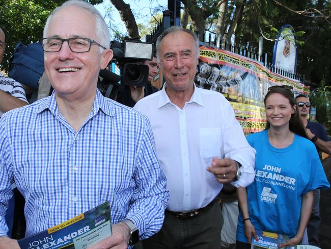 Prime Minister Malcolm Turnbull with the Liberal Candidate for Bennelong John Alexander and his daughter Georgia, at Gladesville Public School today. Picture: Tim Hunter.