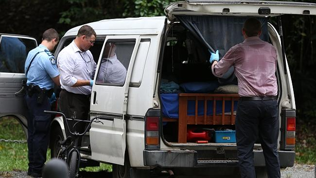 Police officers search the van belonging to the man who died.