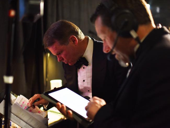 Cullinan studies a run sheet backstage. Picture: Rex Features / Splash News