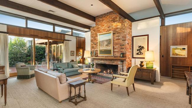 A brick fireplace is the centrepiece of the main living area.