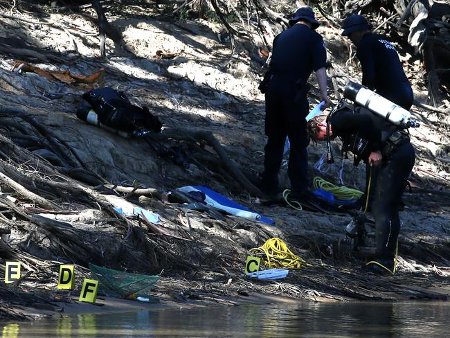 Victorian police divers search the Murray River missing five-year-old boy. Picture: Hamish Blair