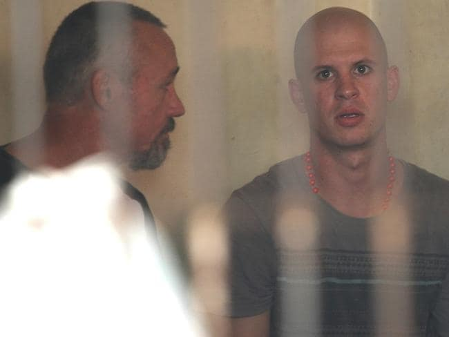 In custody since his arrest in January ... Nicholas James Langan, of Townsville, talks with New Zealander Anthony De Malmanche (left) inside a cell at Denpasar District Court. Picture: Lukman S. Bintoro