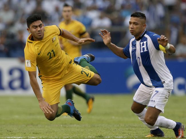 Massimo Luongo feels the full force of a tackle.