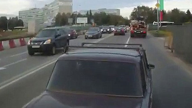This Lada cuts right in front of Alexei Volkov's bus, as caught by his dashcam. Picture: Alexei Volkov, via YouTube