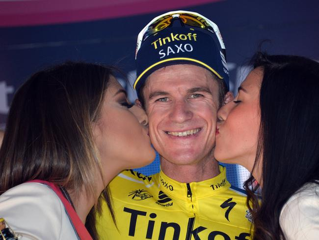 Bouncing back ... Australia's Michael Rogers, who was cleared of doping last month, celebrates on podium after winning the 11th stage of the Giro d'Italia, Tour of Italy cycling race.