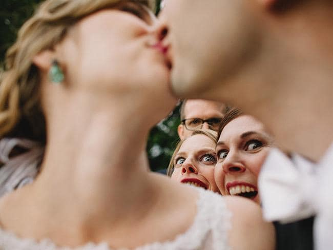 This couple of friends photobomb the wedded couple. Picture: KEN PAK / ISPWP / CATERS NEWS