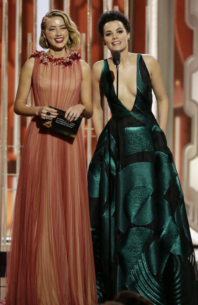 Presenters Amber Heard and Jaimie Alexander onstage during the 73rd Annual Golden Globe Awards at The Beverly Hilton Hotel on January 10, 2016 in Beverly Hills, California. (Photo by Paul Drinkwater/NBCUniversal via Getty Images)