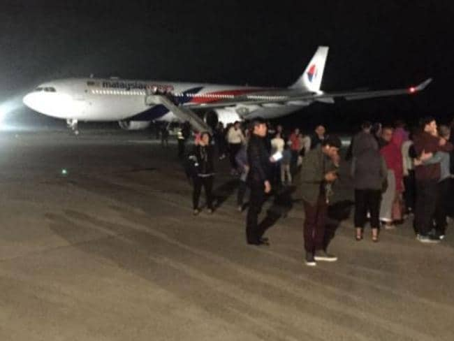Passengers leave the Malaysia Airlines Airbus. Picture: Twitter