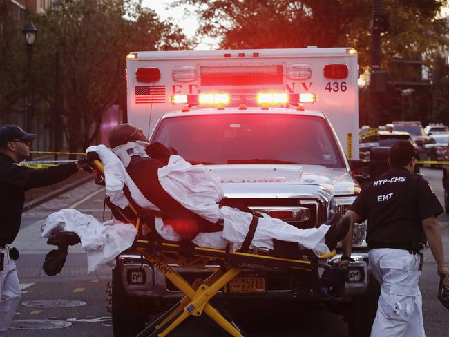 Emergency personnel transport a man on a stretcher after a motorist drove onto a busy bicycle path near the World Trade Centre memorial and struck several people. Picture: AP