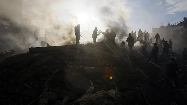 Members of the Palestinian civil defence services work on the rubble of the destroyed house of Hamas leader of Nizar Rayyan following an Israeli air strike in Jabalia in the northern Gaza Strip in January 2009. Picutre: AFP
