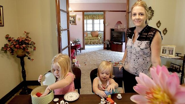 """Danielle Tyley with daughters Matilda, 4, and Zara, 20 months, look around this 1947-built property at  <a href=""""http://www.realestate.com.au/property-house-qld-enoggera-115985815#"""">169 Wardell St, Enoggera</a>. Picture: Mark Cranitch."""