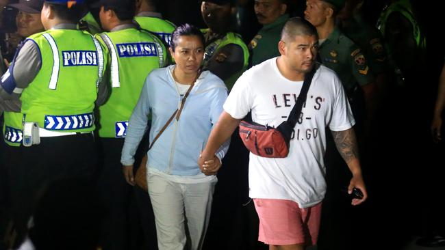 Heartache ... Michael Chan and Febyanti Herewila, the girlfriend of Andrew Chan, arrive at Kerbokan prison to watch the transfer take place. Picture: Adam Taylor