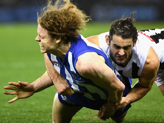 Brodie Grundy tackles Ben Brown. (Photo by Quinn Rooney/Getty Images)
