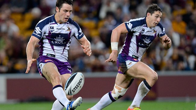 Storm halfback Cooper Cronk kicks for teammate Billy Slater. Picture: Bradley Kanaris