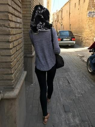 A young woman walks through an alley in Shiraz. Picture: Rohan Smith