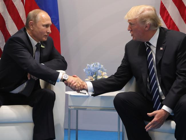 US President Donald Trump, right, and Russian President Vladimir Putin have their first meeting. Picture: AP
