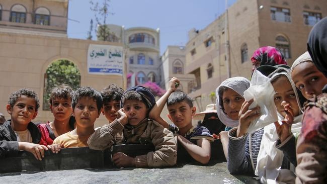 Yemeni children wait to receive food rations provided by a local charity, in Sanaa, Yemen, Thursday, April, 13, 2017. Picture: AP/Hani Mohammed.