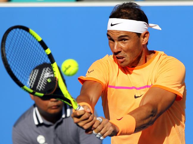 Rafael Nadal crushes a backhand winner against Raonic.