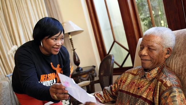 Zindzi Mandela, the youngest daughter of Mandela shows him a letter at his home in 2010. Source: AFP.