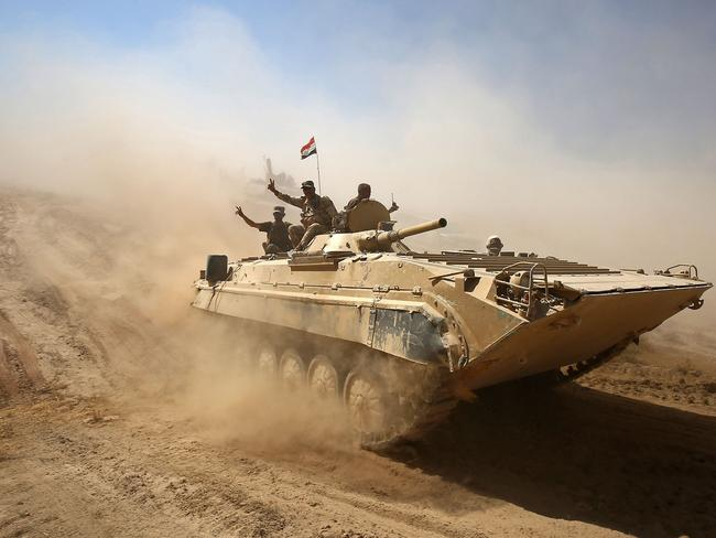 Iraqi forces advance towards the town of Tal Afar, west of Mosul, after the Iraqi government announced the beginning of the operation to retake it from the control of the Islamic State. Picture: AFP PHOTO / AHMAD AL-RUBAYE