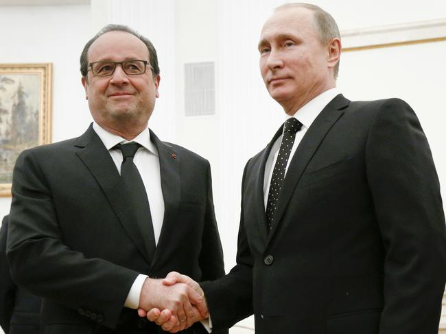 Russian President Vladimir Putin, right, shakes hands with his French counterpart Francois Hollande last year. Picture: AP Photo/Alexander Zemlianichenko