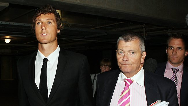 Kurt Tippett leaves the AFL Commission with his legal counsel David Gallbally. Picture: Norm Oorloff