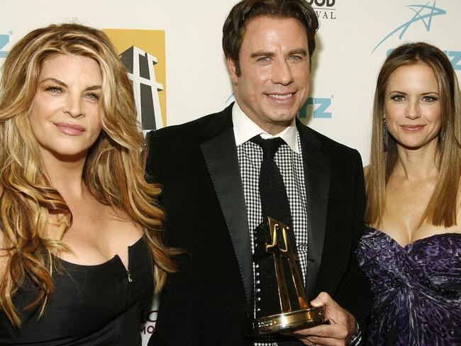 Not friendly ... Tom Cruise reportedly doesn't like John Travolta and Kirstie Alley, seen here with Travolta's wife Kelly Preston. Picture: AP