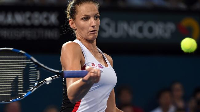 Karolina Pliskova hits a return against Alize Cornet in the Brisbane International women's final.