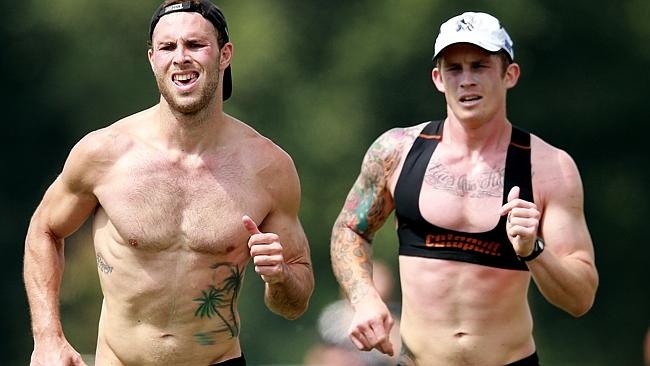 Dayne Beams (right) pushes himself on the track. Picture: Wayne Ludbey