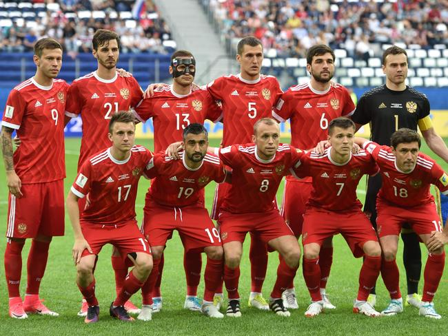 Russia pose for a photo before a game at the Confederations Cup this month. Four of the players from 2014 are part of the squad. Picture: AFP/Mladen Antonov