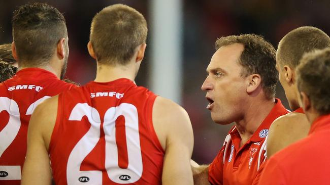 Sydney Swans coach John Longmire speaks to his players at quarter time.