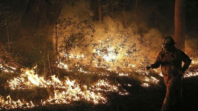 Firefighters control flames during hazard reduction in Bilpin. (AP Photo/Rob Griffith)