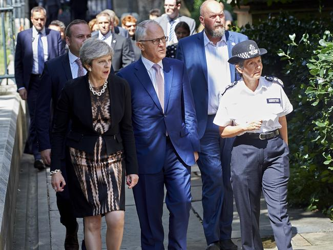 Australian Prime Minister Malcolm Turnbull walks with Britain's Prime Minister Theresa May, left, and Metropolitan Police Commissioner Cressida Dick, centre right, at the Borough Market area. Picture: Niklas Hallen/Pool via AP