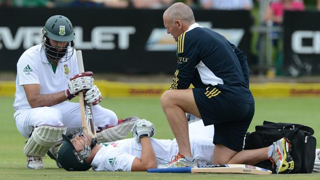 Faf du Plessis gets treatment after being struck in the groin. It happens to him way too much.