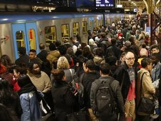 Train chaos at Flinders Street Station. Crowds pack the platforms waiting for trains to move due to a signaling fault. Picture: David Caird