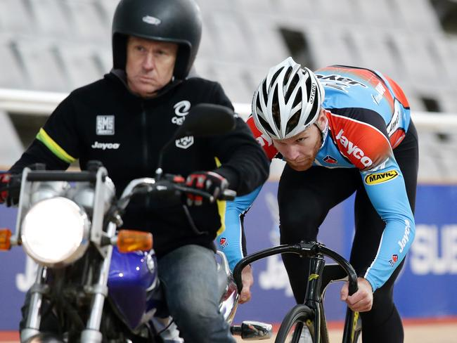 Pete Lewis sits behind David Short on the motorbike during a training session at the SuperDrome. Picture: Sarah Reed