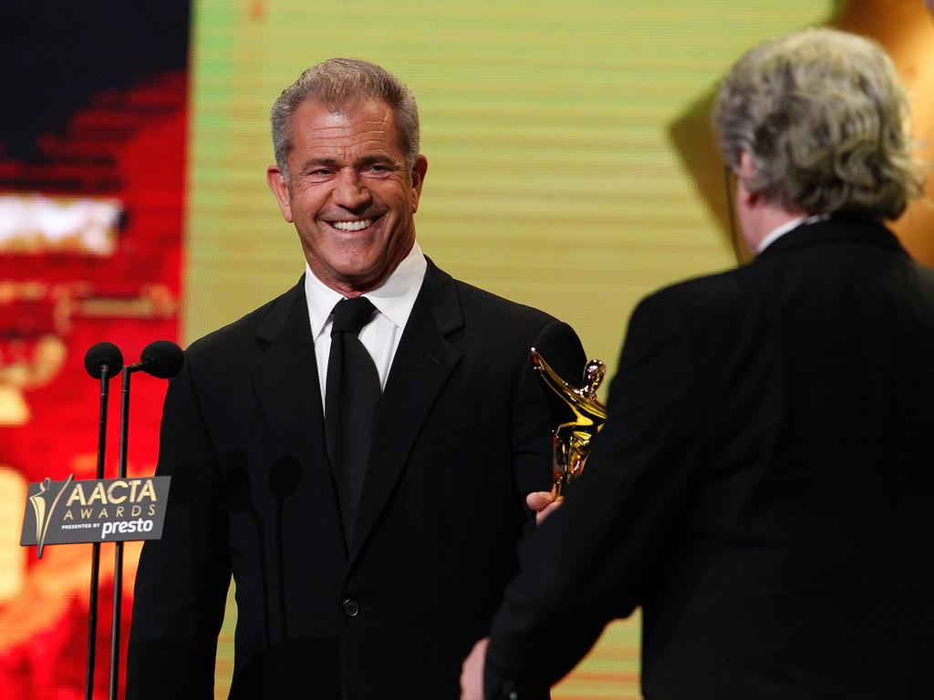 Mel Gibson congratulates George Miller on winning an AACTA Award during the 5th AACTA Awards Presented by Presto at The Star on December 9, 2015 in Sydney, Australia. Picture: Getty