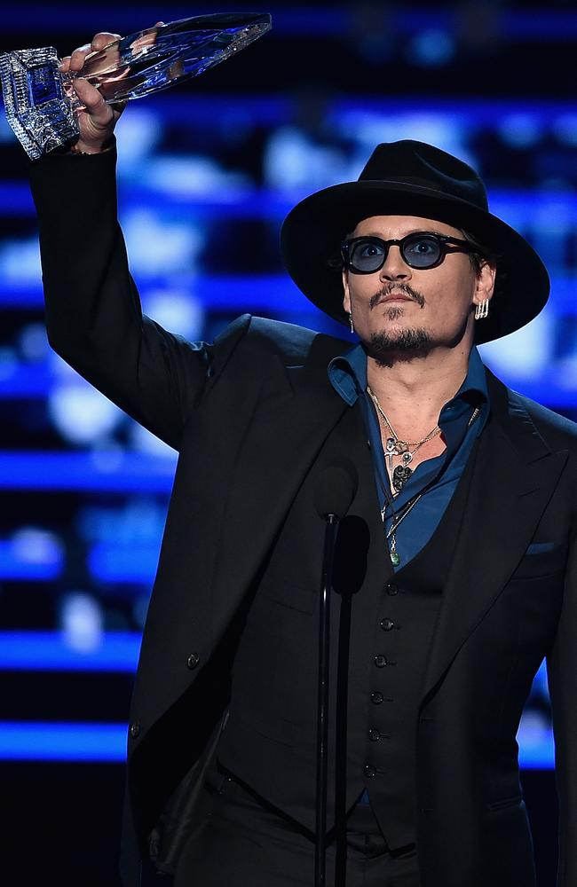 Johnny Depp accepts Favorite Dramatic Movie Actor award onstage during the People's Choice Awards. Picture: Getty