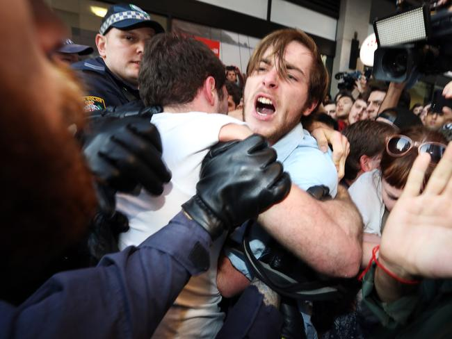 Anger over fees ... Police clash with protesters on George Street.