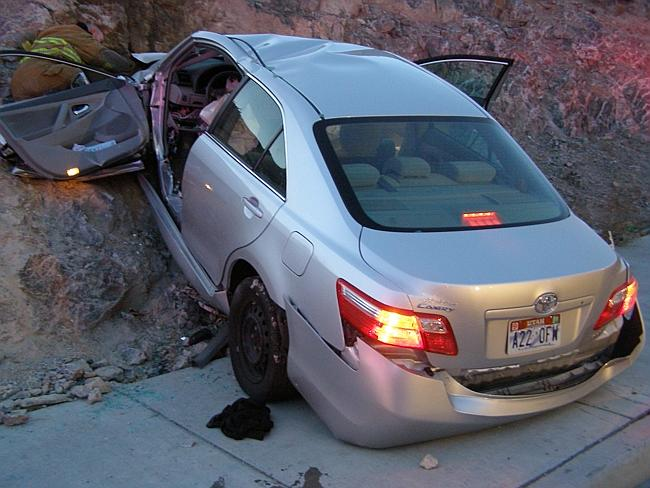 Safety fears...A 2010 file photo shows a Toyota Camry after a crash that killed two people. The crash is believed to have been caused by problems with the car's accelerator or floor mat. Picture: AFP