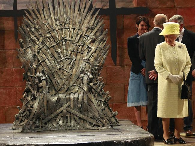 """We are not impressed"" … Queen Elizabeth declines an invitation to sit on the Iron Throne during her visit to the  <i>Game of Thrones</i> set. Picture: AP Photo/Peter Morrison"