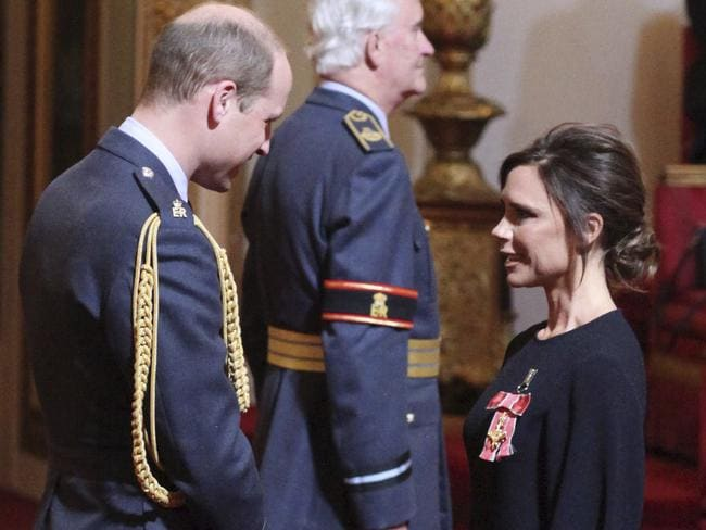 Fashion designer Victoria Beckham receives her OBE from Britain's Prince William, the Duke of Cambridge during an investiture ceremony at Buckingham Palace in London on Wednesday. Picture: Yui Mok/PA via AP