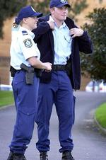 <p>Constable Rod Rankin and Senior Constable Helen Taylor test out new police uniforms which include new boots, cargo pants, new belt, caps and jackets in May 2002. Picture: Herald Sun</p>