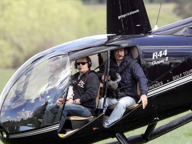 Paparazzo Jamie Fawcett pictured in the front of a chopper keen to snap Kate Ritchie's wedding in Tasmania.